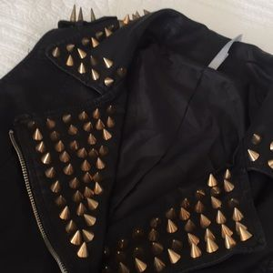 Leather vest with copper studs